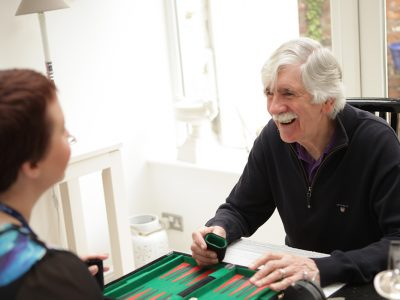Carer and Client playing a game   Bridgewater Home Care
